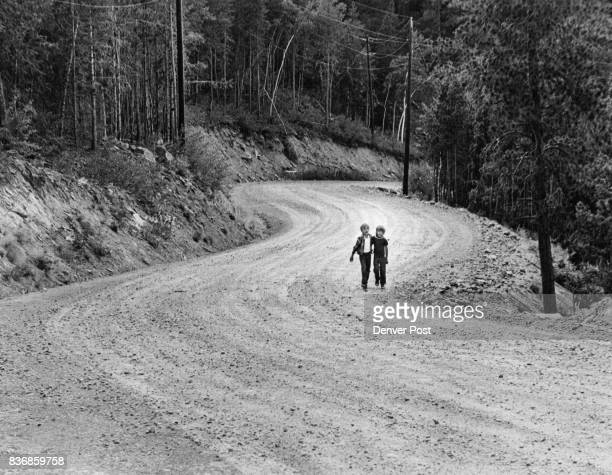 Gary Layman And Jesse Howe Walk Up Winding Road Which Jefferson School Board Judges Too Dangerous At Present For Buses Residents from the Hilldale...