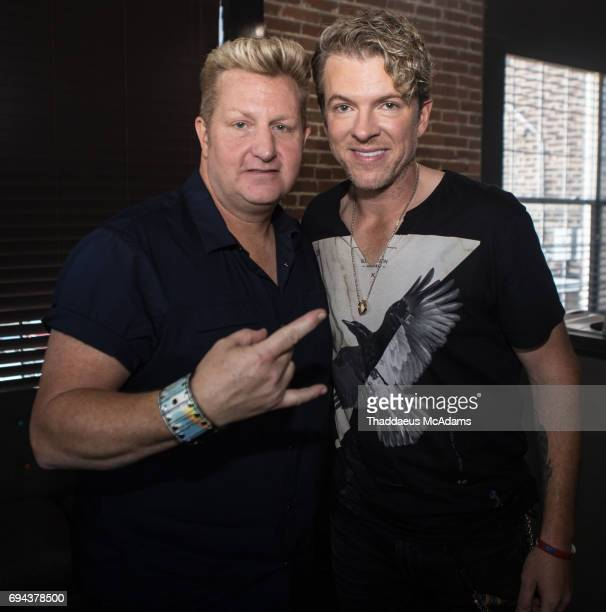 Gary Levox and Joe Don Rooney of Rascal Flatts pose backstage on June 9 2017 in Nashville Tennessee