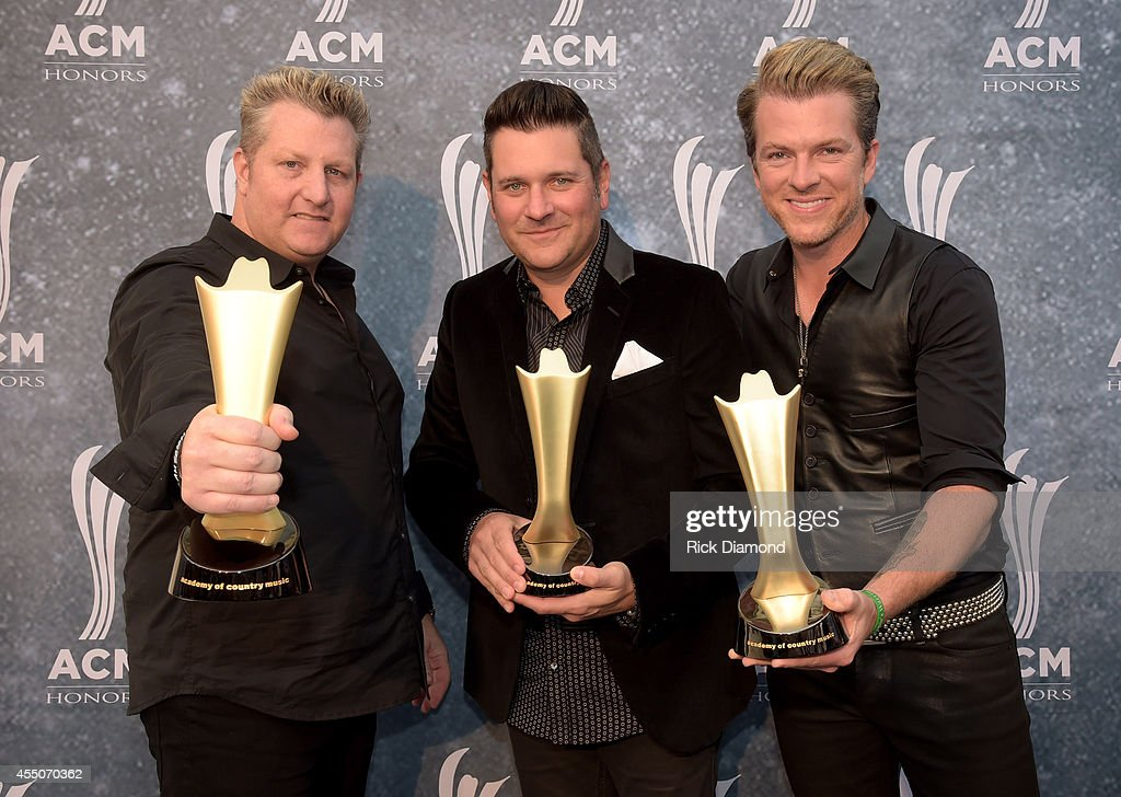 Gary LeVox Jay DeMarcus and Joe Don Rooney of Rascal Flatts attend the 8th Annual ACM Honors at Ryman Auditorium on September 9 2014 in Nashville...