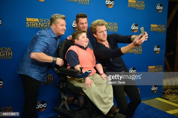 Gary LeVox Jay DeMarcus Bryson Foster and Joe Don Rooney take a selfie at Grand Ole Opry House on June 6 2014 in Nashville Tennessee