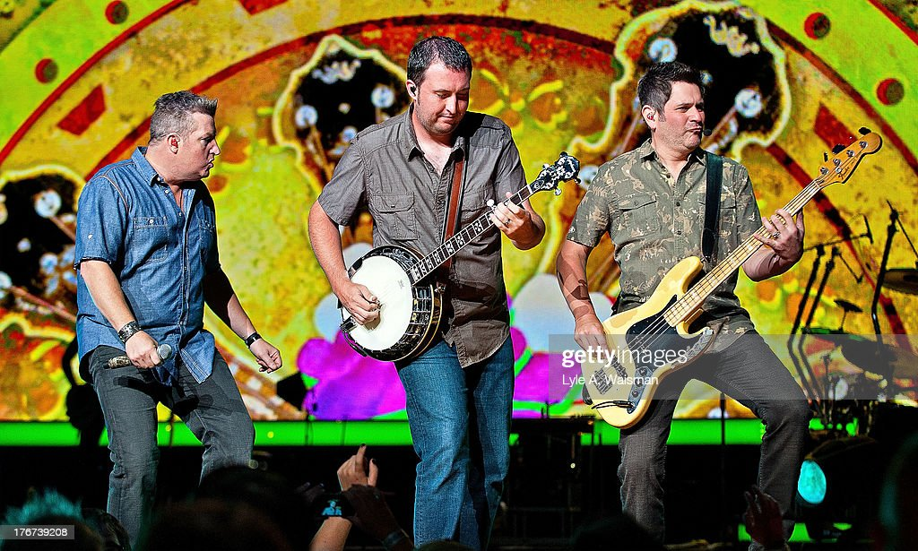 Gary LeVox, Travis Toy and <a gi-track='captionPersonalityLinkClicked' href=/galleries/search?phrase=Jay+DeMarcus&family=editorial&specificpeople=224578 ng-click='$event.stopPropagation()'>Jay DeMarcus</a> of the American country music group Rascal Flatts perform at First Midwest Bank Amphitheatre on August 17, 2013 in Tinley Park, Illinois.