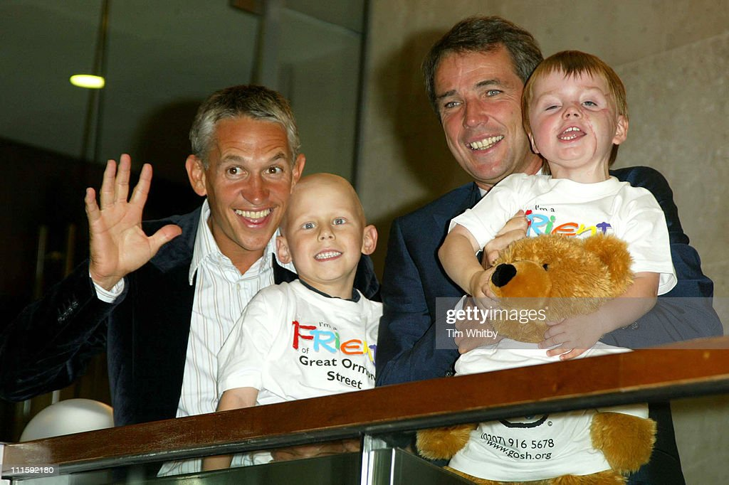 Gary Lineker and Alan Hansen with Tommy Morgan (3) and Ethan Foster (6) who are both Great Ormond Street Hospital patients.