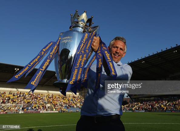 Gary Lineker poses for a picture with the Premier League Trophy prior to the preseason friendly between Oxford City and Leicester City at Kassam...