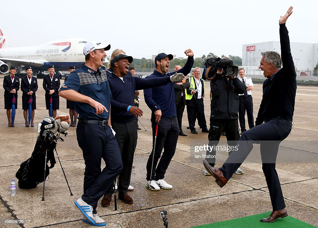 Gary Lineker reacts after playing a shot to a target 180 yards away during an event to raise funds for the Kate and Justin Rose Foundation at Heathrow Airport on September 29, 2014 in London, England. British Airways has donated flights to the Kate and Justin Rose foundation, which was created to inspire children through nutrition, education and experiences