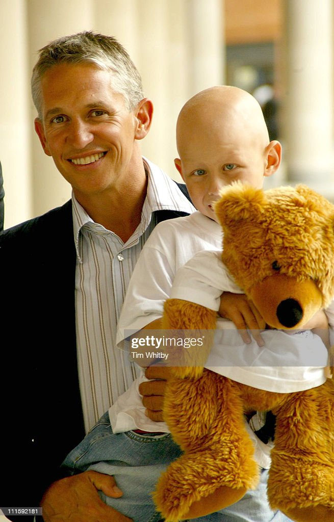 Gary Lineker with Tommy Morgan (3) who is a Great Ormond Street Hospital patient, at the London Stock Exchange. They were their to launch the Bull and Bear Appeal, urging directors to 'Share their shares'.