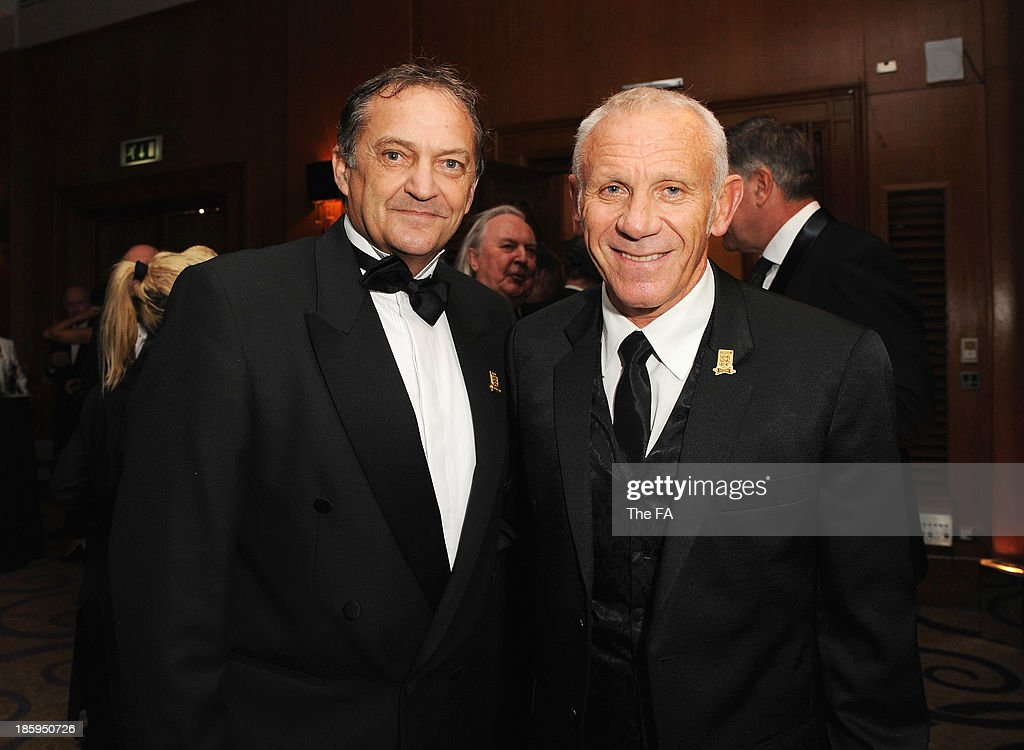 Gary Mabbutt and <a gi-track='captionPersonalityLinkClicked' href=/galleries/search?phrase=Peter+Reid&family=editorial&specificpeople=654041 ng-click='$event.stopPropagation()'>Peter Reid</a> pose during the FA150 Gala Dinner commemorating the Football Association's 150th year at the Grand Connaught Rooms on October 26, 2013 in London, England.