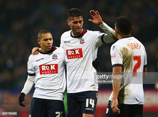 Gary Madine of Bolton Wanderers celebrates scoring his team's first goal with his team's first goal with his team mate Wellington Silva and Liam...