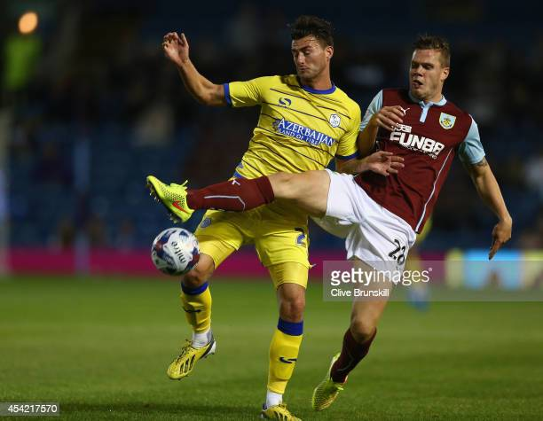 Gary Madine of Sheffield Wednesday in action with Kevin Long of Burnley during the Capital One Cup Second Round match between Burnley and Sheffield...