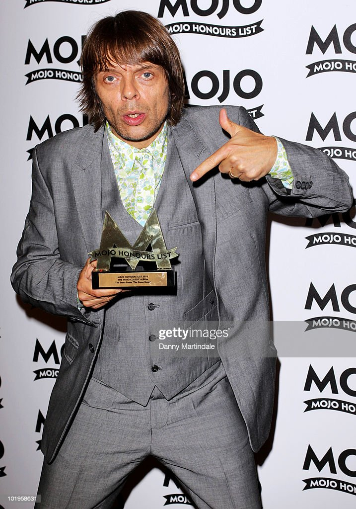 Gary Manny 'Mani' Mounfield from The Stone Roses with award at The Mojo Honours List at The Brewery on June 10, 2010 in London, England.