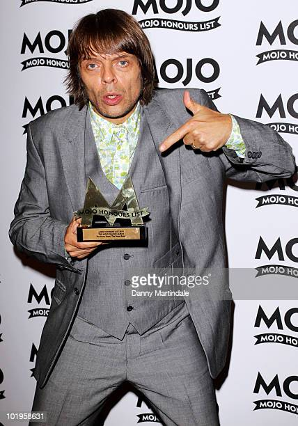 Gary Manny 'Mani' Mounfield from The Stone Roses with award at The Mojo Honours List at The Brewery on June 10 2010 in London England