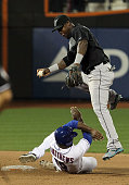 Gary Matthews Jr of the New York Mets is forced out at second base in the seventh inning but is able to break up a double play attempt by Hanley...