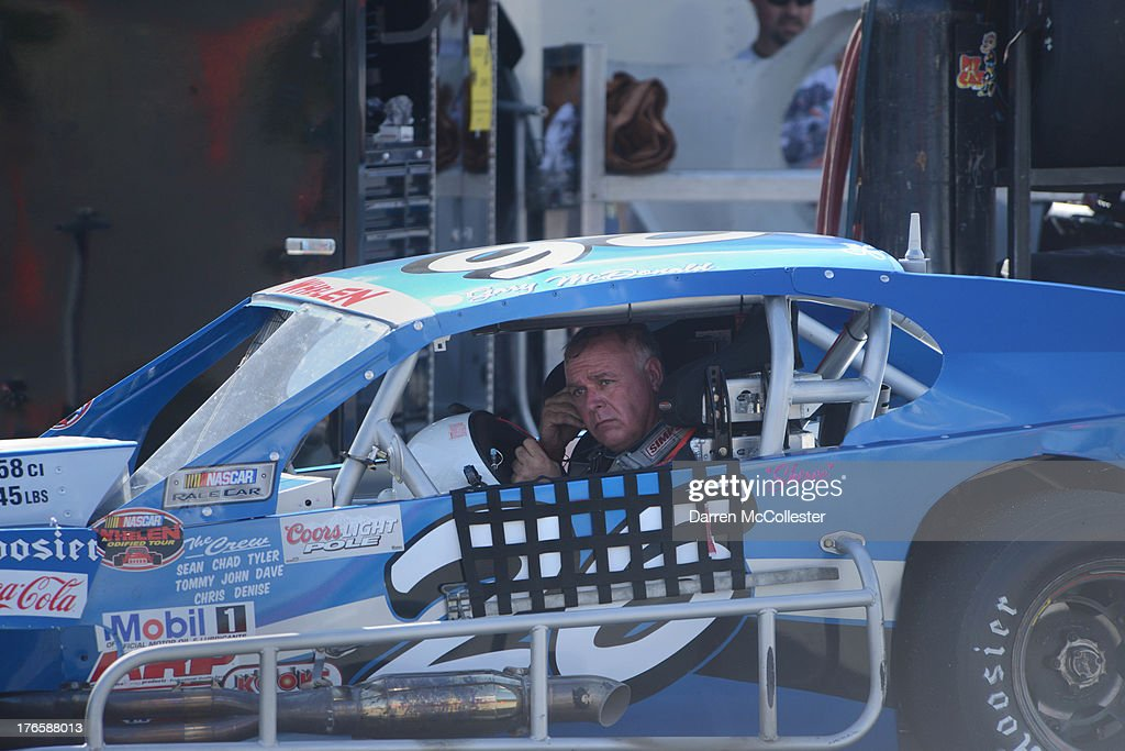 Gary McDonald driver of the #26 Lakeland Landscape/TRC Electric Pontiac exits hs vehicle after practice during the Budweiser King of Beers 150 at Thompson Speedway August 15, 2013 in Thompson, Connecticut.