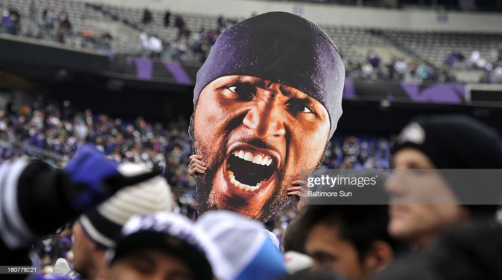 Gary McHugh Jr. lifts a visage of Baltimore Ravens' Ray Lewis during a Super Bowl celebration at M&T Bank Stadium in Baltimore, Maryland, Tuesday, February 5, 2013.