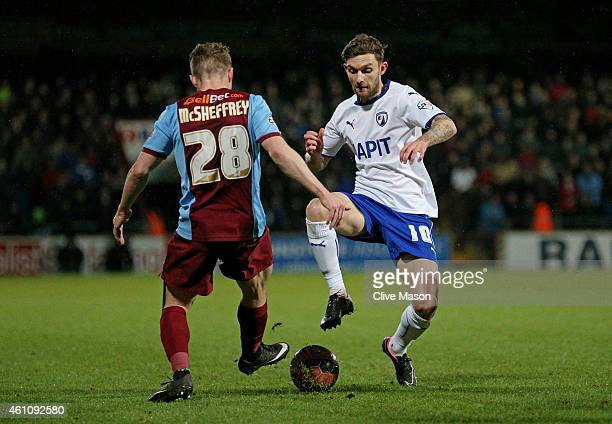 Gary McSheffrey of Scunthorpe and Jay O'Shea of Chesterfield compete for the ball during the FA Cup Third Round match between Scunthorpe United and...