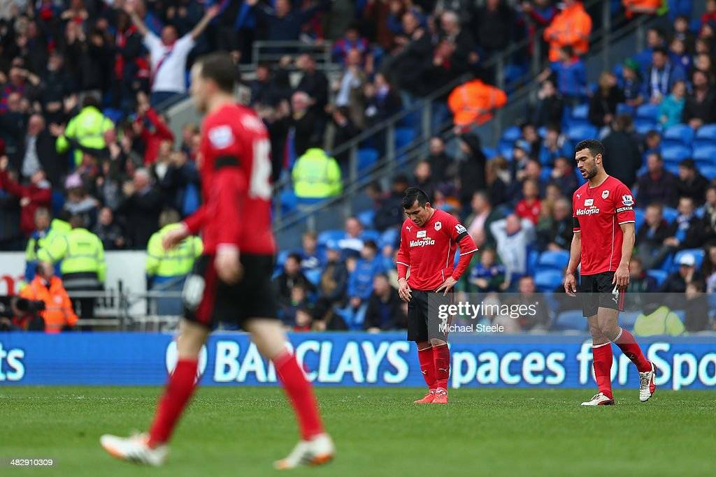 <a gi-track='captionPersonalityLinkClicked' href=/galleries/search?phrase=Gary+Medel&family=editorial&specificpeople=4123504 ng-click='$event.stopPropagation()'>Gary Medel</a> (C) and <a gi-track='captionPersonalityLinkClicked' href=/galleries/search?phrase=Steven+Caulker+-+Soccer+Player&family=editorial&specificpeople=6527106 ng-click='$event.stopPropagation()'>Steven Caulker</a> (R) of Cardiff City are dejected after conceding the third goal during the Barclays Premier League match between Cardiff City and Crystal Palace at Cardiff City Stadium on April 5, 2014 in Cardiff, Wales.