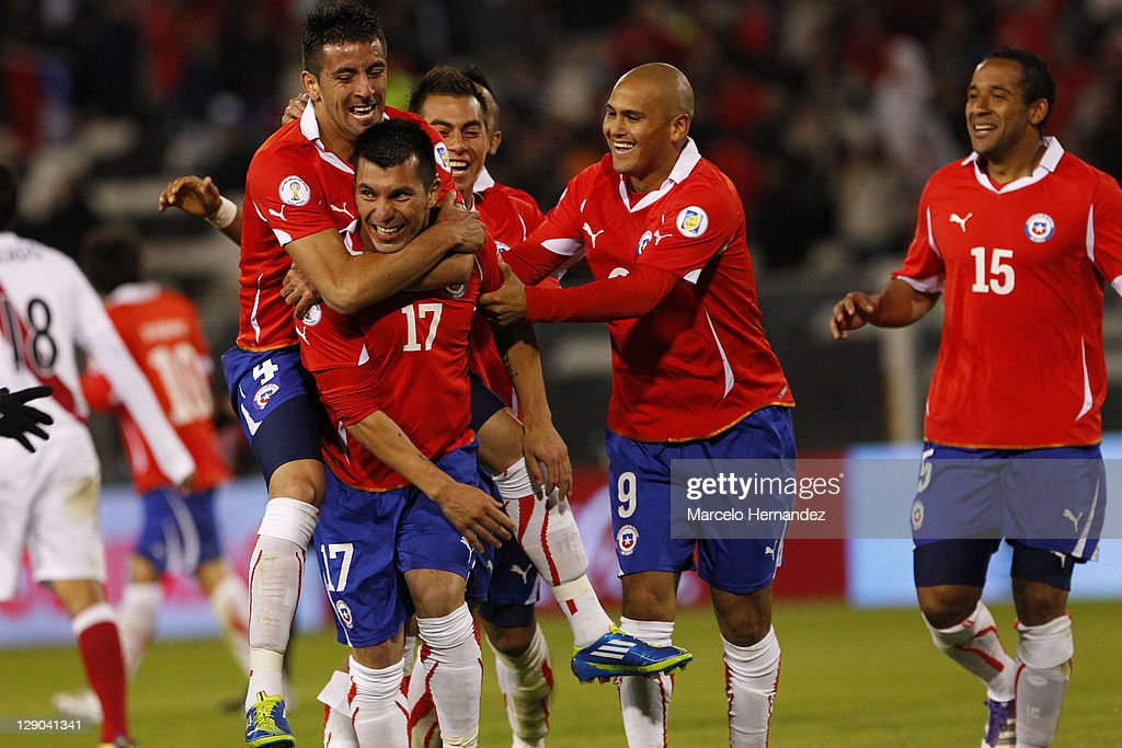 <a gi-track='captionPersonalityLinkClicked' href=/galleries/search?phrase=Gary+Medel&family=editorial&specificpeople=4123504 ng-click='$event.stopPropagation()'>Gary Medel</a> (C), from Chile, celebrates his goal aganist Peru, during the match between Chile and Peru as part of the first round of the South American Qualifiers for Brazil 2014 FIFA World Cup on October 11, 2011 in Santiago, Chile.