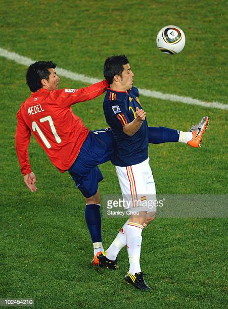 Gary Medel of Chile and David Villa of Spain battle for the ball during the 2010 FIFA World Cup South Africa Group H match between Chile and Spain at...