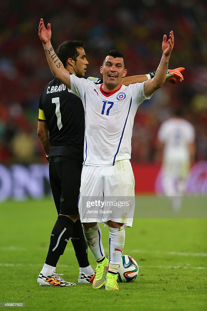 <a gi-track='captionPersonalityLinkClicked' href=/galleries/search?phrase=Gary+Medel&family=editorial&specificpeople=4123504 ng-click='$event.stopPropagation()'>Gary Medel</a> of Chile celebrates after defeating Spain 2-0 during the 2014 FIFA World Cup Brazil Group B match between Spain and Chile at Maracana on June 18, 2014 in Rio de Janeiro, Brazil.