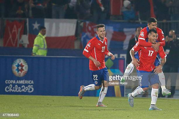Gary Medel of Chile celebrates with teammates after scoring the fourth goal of his team during the 2015 Copa America Chile Group A match between...