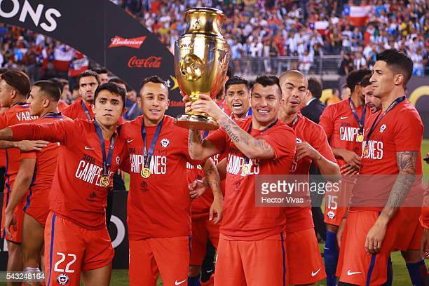 Gary Medel of Chile celebrates with the trophy during the championship match between Argentina and Chile at MetLife Stadium as part of Copa America...
