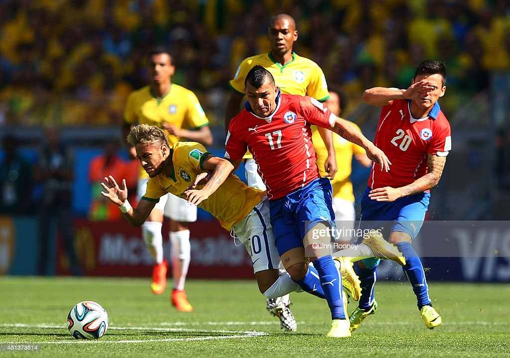 Gary Medel of Chile challenges Neymar of Brazil during the 2014 FIFA World Cup Brazil round of 16 match between Brazil and Chile at Estadio Mineirao on June 28, 2014 in Belo Horizonte, Brazil.