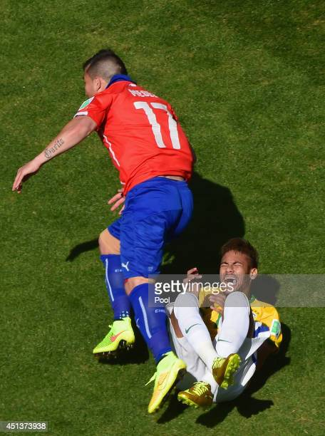 Gary Medel of Chile challenges Neymar of Brazil during the 2014 FIFA World Cup Brazil round of 16 match between Brazil and Chile at Estadio Mineirao...