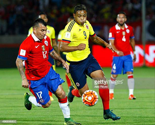 Gary Medel of Chile fights for the ball with Luis Muriel of Colombia during a match between Chile and Colombia as part of FIFA 2018 World Cup...