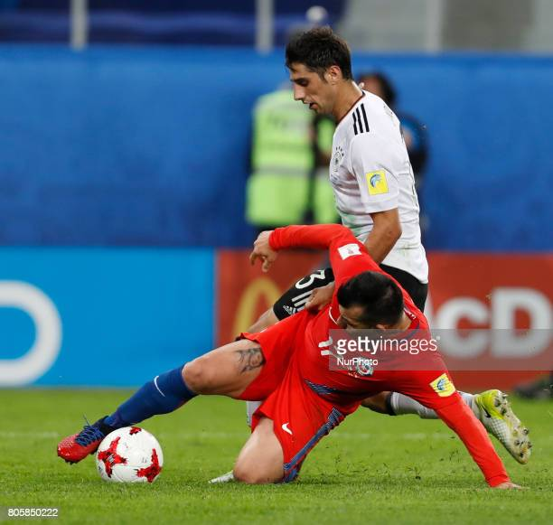 Gary Medel of Chile national team and Lars Stindl of Germany national team vie for the ball during FIFA Confederations Cup Russia 2017 final match...