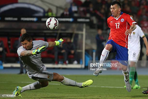 Gary Medel of Chile scores the fourth goal of his team during the 2015 Copa America Chile Group A match between Chile and Bolivia at Nacional Stadium...
