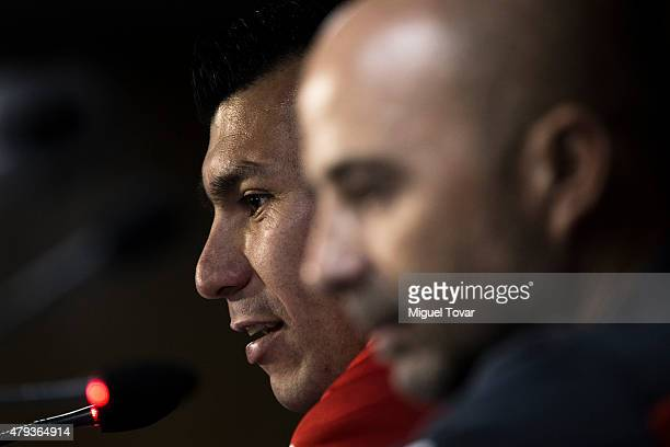 Gary Medel of Chile talks next to Jorge Sampaoli coach of Chile during a press conference at Nacional Stadium on July 03 2015 in Santiago Chile Chile...