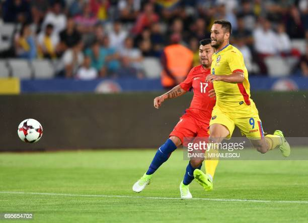 Gary Medel of Chile vies for the ball with Florin Andone of Romania during their international friendly football matchbetween Romania and Chile in...