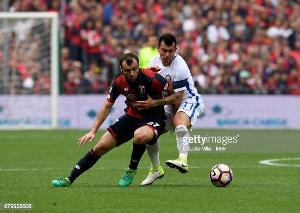 Gary Medel of FC Internazionale and Goran Pandev of Genoa CFC compete for the ball during the Serie A match between Genoa CFC and FC Internazionale...