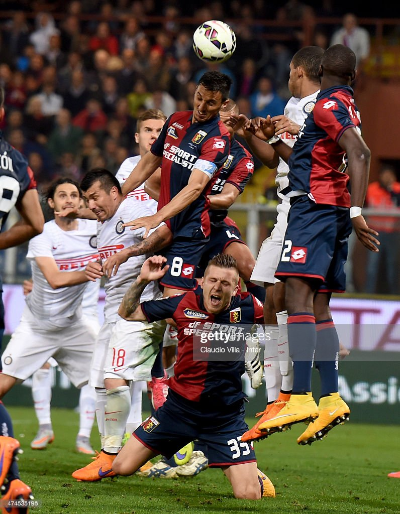 Gary Medel of FC Internazionale and Nicolas Burdisso of Genoa CFC compete for the ball during the Serie A match between Genoa CFC and FC...