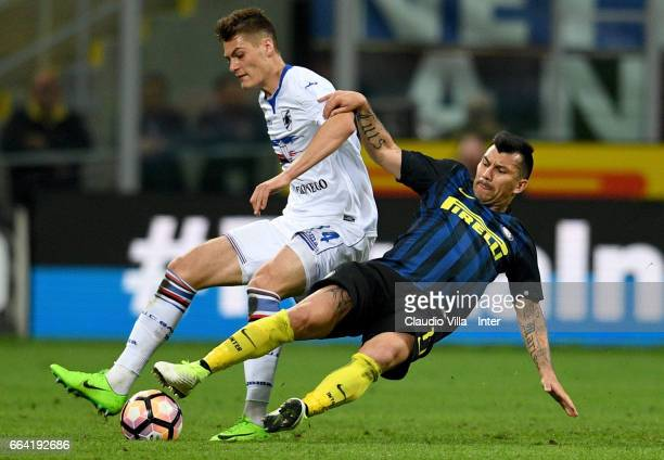 Gary Medel of FC Internazionale competes for the ball with Patrik Schick of UC Sampdoria during the Serie A match between FC Internazionale and UC...