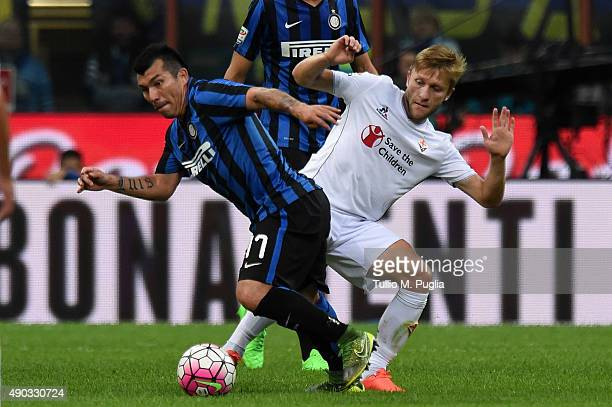 Gary Medel of Internazionale Milano is challenged by Jakub Blaszczykowski of Fiorentina during the Serie A match between FC Internazionale Milano and...