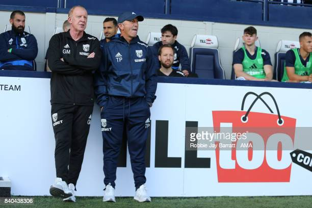 Gary Megson assistant head coach / manager and Tony Pulis manager / head coach of West Bromwich Albion during the Premier League match between West...