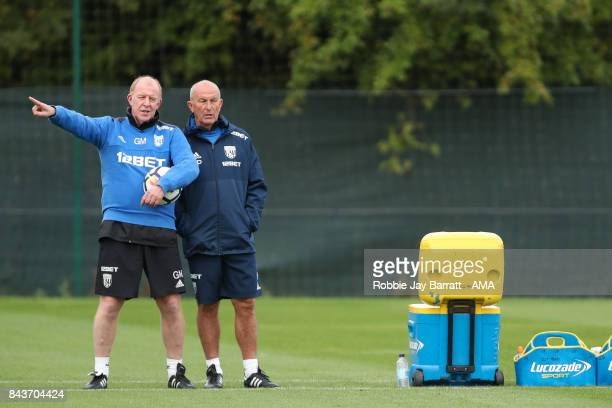 Gary Megson assistant head coach / manager of West Bromwich Albion and Tony Pulis manager / head coach of West Bromwich Albion on September 7 2017 in...