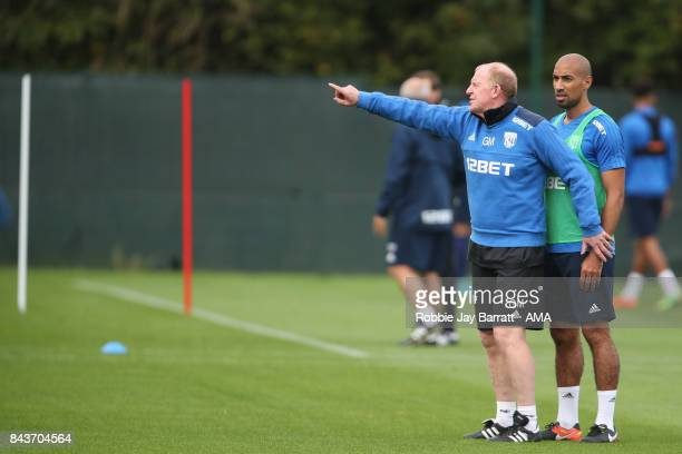 Gary Megson assistant head coach / manager of West Bromwich Albion and Karl Henry on September 7 2017 in West Bromwich England