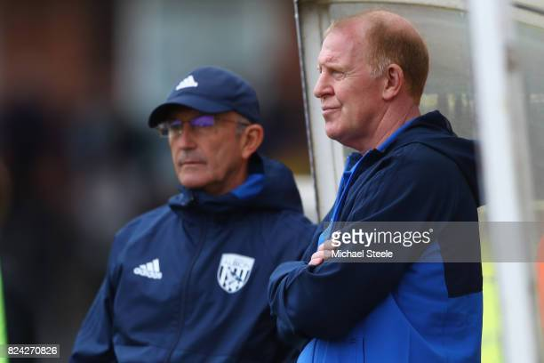 Gary Megson the assistant coach of West Bromwich Albion looks on alongside manager Tony Pulis during the pre season match between Bristol Rovers and...
