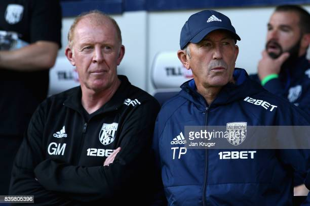 Gary Megson West Bromwich Albion assistant head coach and Tony Pulis Manager of West Bromwich Albion looks on prior to the Premier League match...