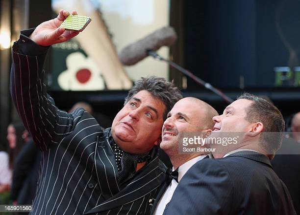 Gary Mehigan Matt Preston and George Calombaris pose for a photograph on their mobile phone as they arrive at the 2013 Logie Awards at the Crown on...