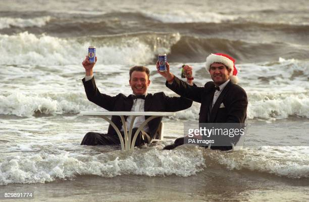 Gary Miller and friend Gary Johnson brave the freezing north sea as hundreds plunged into the sea today at Sunderland's seaside resort Seaburn and...