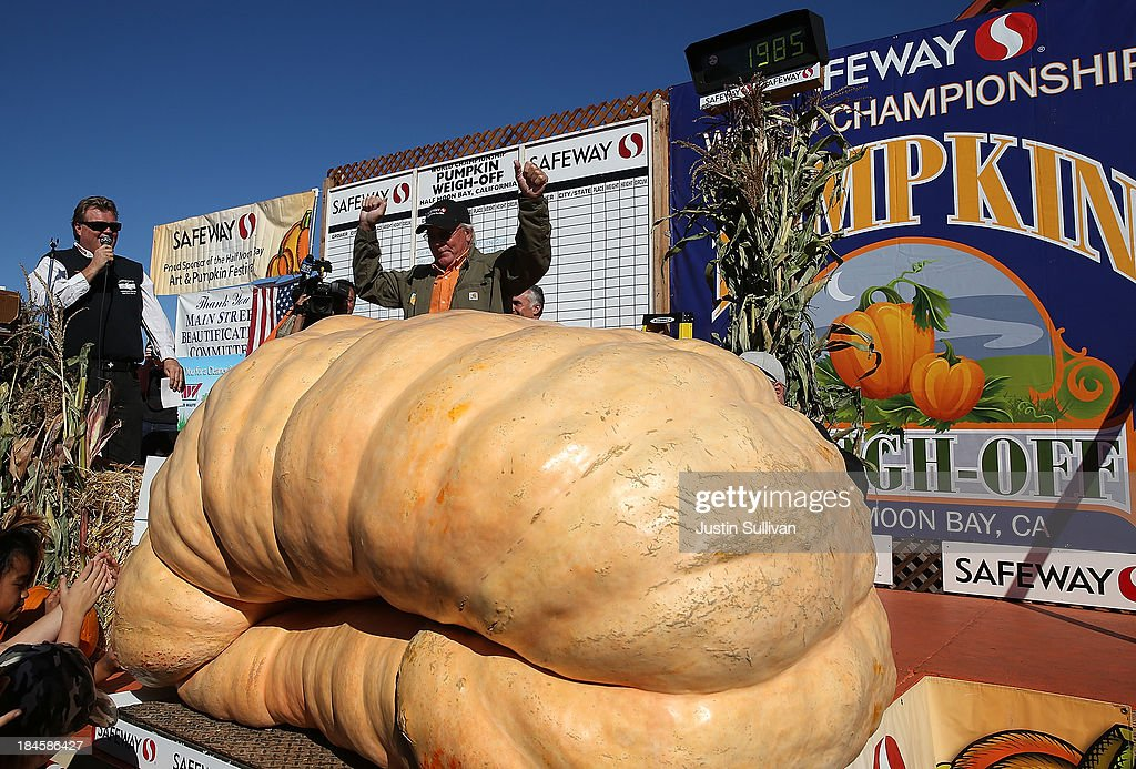 Gary Miller of Napa California celebrates after winning the 40th Annual Safeway World Championship Pumpkin WeighOff on October 14 2013 in Half Moon...