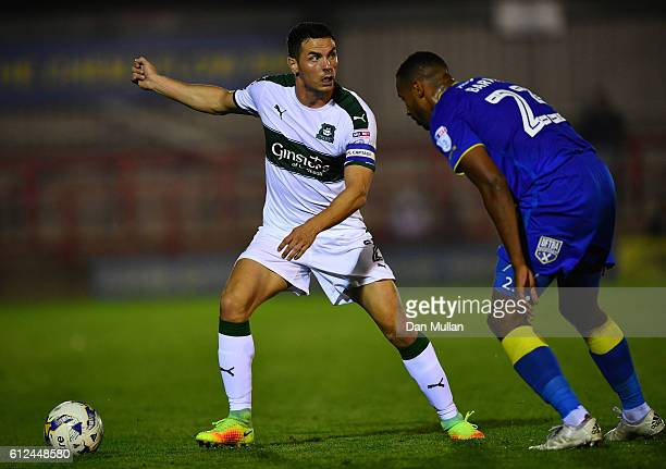 Gary Miller of Plymouth Argyle holds off Tyrone Barnett of AFC Wimbledon during the EFL Checkatrade Trophy match between AFC Wimbledon and Plymouth...