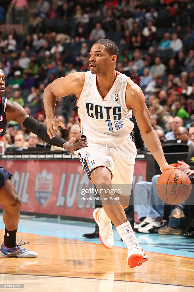<a gi-track='captionPersonalityLinkClicked' href=/galleries/search?phrase=Gary+Neal&family=editorial&specificpeople=5085165 ng-click='$event.stopPropagation()'>Gary Neal</a> #12 of the Charlotte Bobcats dribbles the ball against the Atlanta Hawks during the game at the Time Warner Cable Arena on March 17, 2014 in Charlotte, North Carolina.