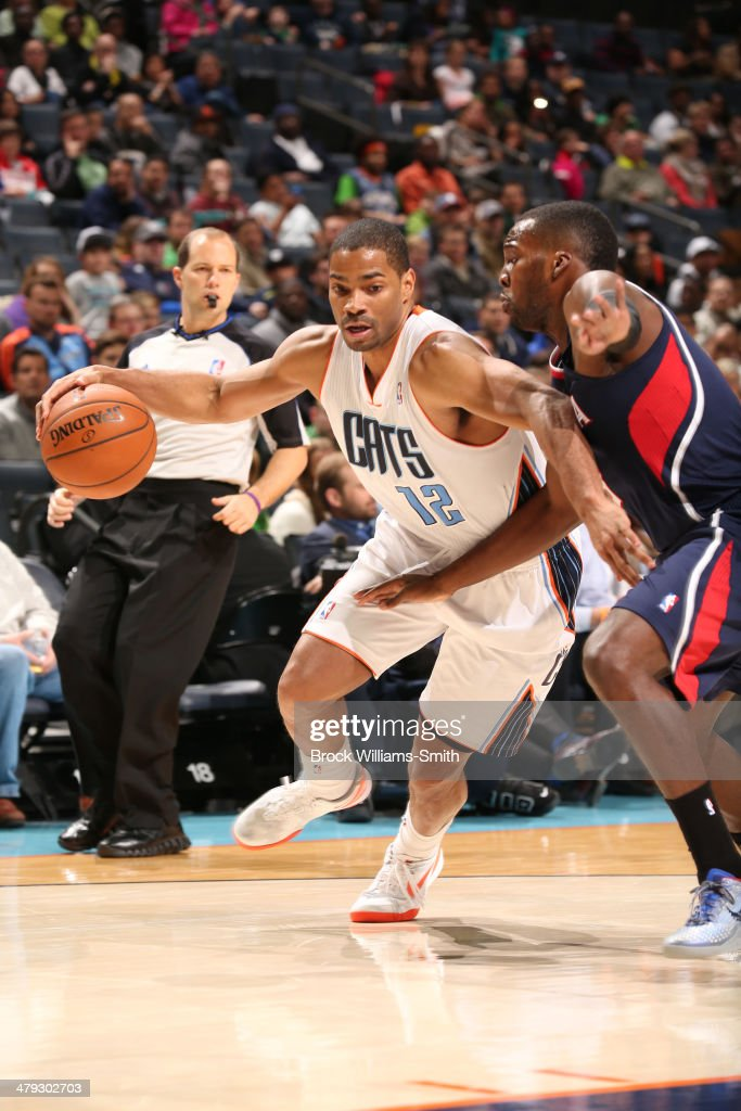 Gary Neal #12 of the Charlotte Bobcats drives against the Atlanta Hawks during the game at the Time Warner Cable Arena on March 17, 2014 in Charlotte, North Carolina.