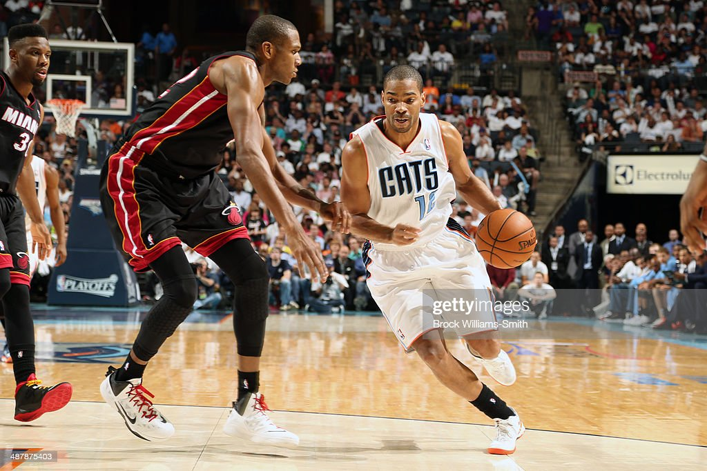 <a gi-track='captionPersonalityLinkClicked' href=/galleries/search?phrase=Gary+Neal&family=editorial&specificpeople=5085165 ng-click='$event.stopPropagation()'>Gary Neal</a> #12 of the Charlotte Bobcats drives against the Miami Heat in Game One of the Eastern Conference Quarterfinals of the 2014 NBA playoffs at the Time Warner Cable Arena on April 28, 2014 in Charlotte, North Carolina.