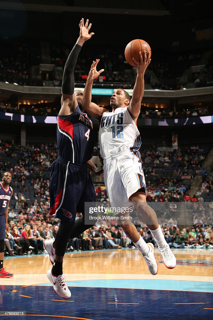 Gary Neal #12 of the Charlotte Bobcats drives to the basket against the Atlanta Hawks during the game at the Time Warner Cable Arena on March 17, 2014 in Charlotte, North Carolina.