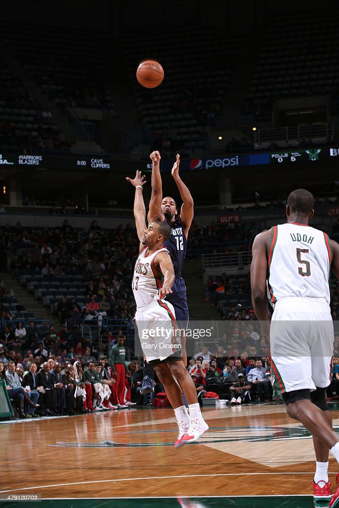Gary Neal #12 of the Charlotte Bobcats shoots against Ramon Sessions #13 of the Milwaukee Bucks on March 16, 2014 at the BMO Harris Bradley Center in Milwaukee, Wisconsin.