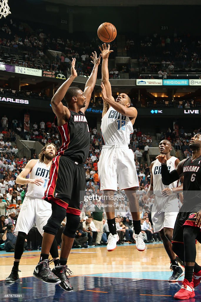 <a gi-track='captionPersonalityLinkClicked' href=/galleries/search?phrase=Gary+Neal&family=editorial&specificpeople=5085165 ng-click='$event.stopPropagation()'>Gary Neal</a> #12 of the Charlotte Bobcats shoots against the Miami Heat in Game One of the Eastern Conference Quarterfinals of the 2014 NBA playoffs at the Time Warner Cable Arena on April 28, 2014 in Charlotte, North Carolina.
